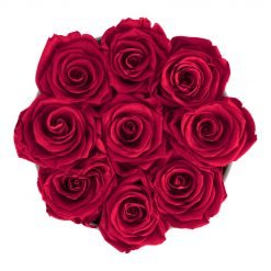 Runde Rosenbox aus hellgrauem Samt mit roten Infinityrosen von oben
