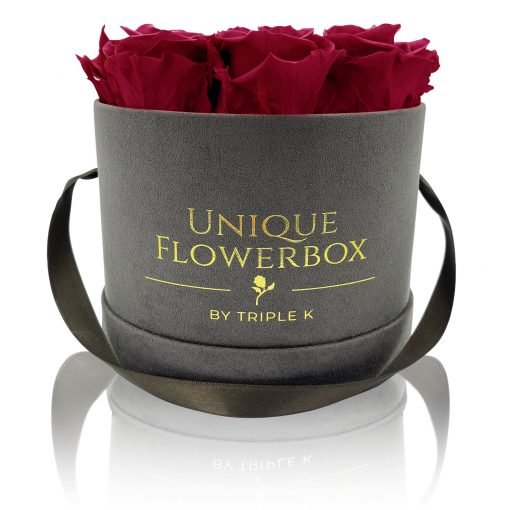 Runde Rosenbox mit roten Infinityrosen, graues Samtfinish und Henkel zum Tragen